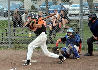 Orangeville's Matt Drury connects with a swing during Saturday's (July 22) NDBL game between the Giants and the Nobleton Cornhuskers on the diamond at the Tottenham Community Centre. The Giants walked away with the game taking an 18-4 win.